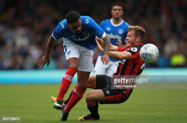 Ryan Fraser of AFC Bournemouth and Tareiq HolmesDennis of Portsmouth in action during a preseason friendly match between Portsmouth and AFC...