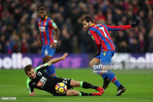 Ryan Fraser of AFC Bournemouth goes to ground under pressure from Yohan Cabaye of Crystal Palace during the Premier League match between Crystal...