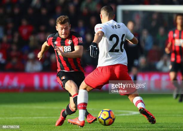 Ryan Fraser of AFC Bournemouth is challenged by Jeremy Pied of Southampton during the Premier League match between AFC Bournemouth and Southampton at...