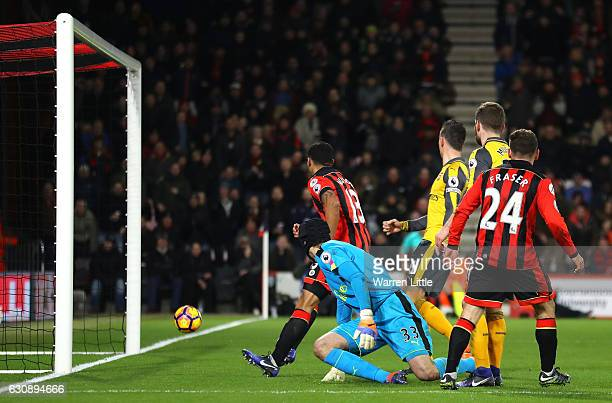 Ryan Fraser of AFC Bournemouth scores his team's third goal past Petr Cech of Arsenal during the Premier League match between AFC Bournemouth and...
