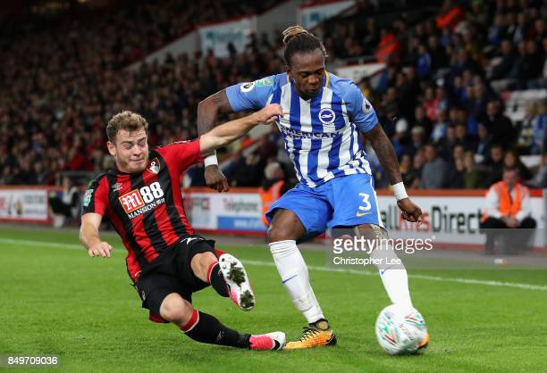 Ryan Fraser of AFC Bournemouth tackles Gaetan Bong of Brighton and Hove Albion during the Carabao Cup Third Round match between AFC Bournemouth and...