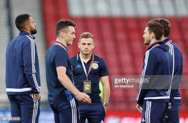 Ryan Fraser of Scotland stands on the pitch with team mates prior to the FIFA 2018 World Cup Group F Qualifier between Scotland and Slovakia at...