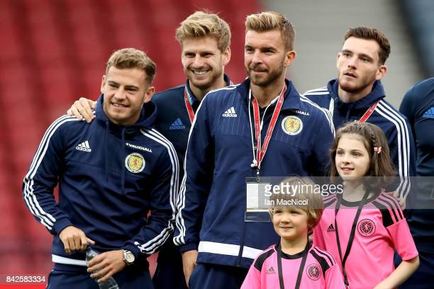 Ryan Fraser Stuart Armstrong James Morrison and Andy Robertson of Scotland pose with mascots prior to the FIFA 2018 World Cup Qualifier between...