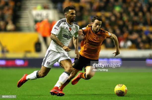 Ryan Fredericks of Fulham is closed down by Diogo Jota of Wolverhampton Wanderers during the Sky Bet Championship match between Wolverhampton...