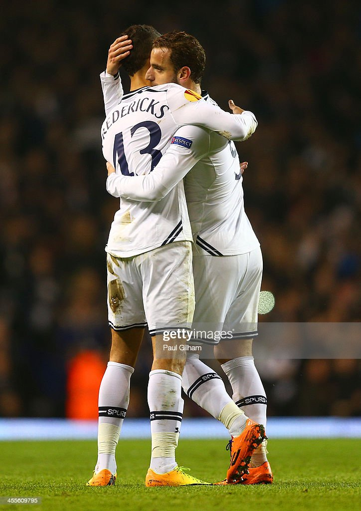Ryan Fredericks of Tottenham Hotspur congratulates <a gi-track='captionPersonalityLinkClicked' href=/galleries/search?phrase=Roberto+Soldado&family=editorial&specificpeople=2095686 ng-click='$event.stopPropagation()'>Roberto Soldado</a> of Tottenham Hotspur after he scored his hat trick goal from the penalty spot during the UEFA Europa League Group K match between Tottenham Hotspur FC and FC Anji Makhachkala at White Hart Lane on December 12, 2013 in London, England.