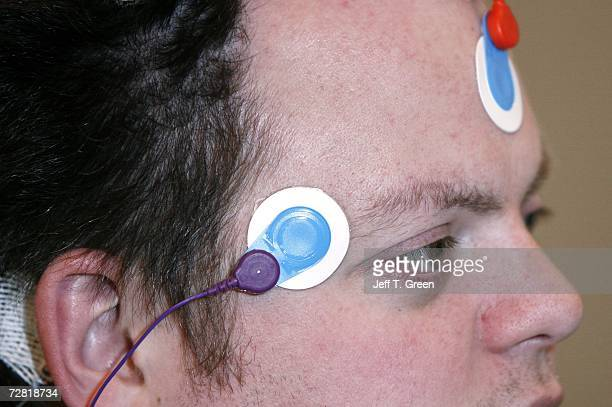 Ryan Gamble has wires applied to his head in preparation for a polysomnographic recording system demonstration at Washington State University...