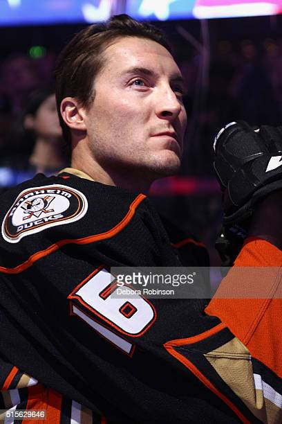 Ryan Garbutt of the Anaheim Ducks listens to the national anthem prior to the game against the New Jersey Devils on March 14 2016 at Honda Center in...