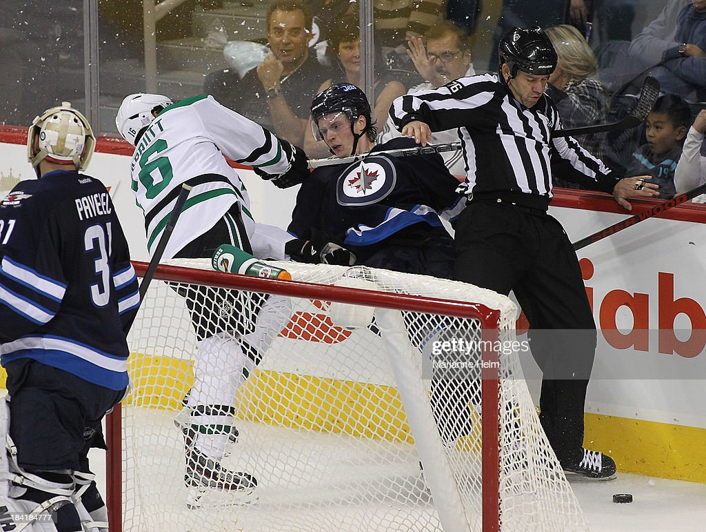 <a gi-track='captionPersonalityLinkClicked' href=/galleries/search?phrase=Ryan+Garbutt&family=editorial&specificpeople=8312174 ng-click='$event.stopPropagation()'>Ryan Garbutt</a> #16 of the Dallas Stars collides with <a gi-track='captionPersonalityLinkClicked' href=/galleries/search?phrase=Jacob+Trouba&family=editorial&specificpeople=8050718 ng-click='$event.stopPropagation()'>Jacob Trouba</a> #8 of the Winnipeg Jets in third-period action of an NHL game at the MTS Centre on October 11, 2013 in Winnipeg, Manitoba, Canada.