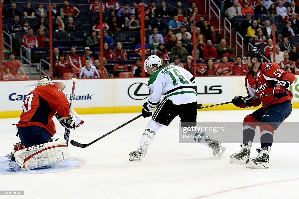Ryan Garbutt #16 of the Dallas Stars skates past Mike Green #52 of the Washington Capitals before scoring a shorthanded goal past Braden Holtby #70 of the Washington Capitals in the third period during an NHL game at Verizon Center on April 1, 2014 in Washington, DC.