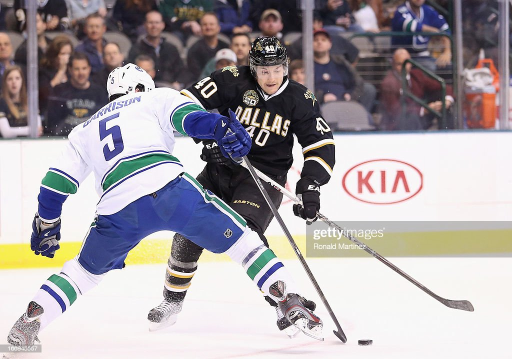 <a gi-track='captionPersonalityLinkClicked' href=/galleries/search?phrase=Ryan+Garbutt&family=editorial&specificpeople=8312174 ng-click='$event.stopPropagation()'>Ryan Garbutt</a> #40 of the Dallas Stars skates the puck against Jason Garrison #5 of the Vancouver Canucks at American Airlines Center on April 18, 2013 in Dallas, Texas.