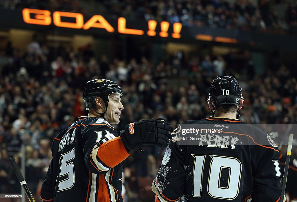 <a gi-track='captionPersonalityLinkClicked' href=/galleries/search?phrase=Ryan+Getzlaf&family=editorial&specificpeople=602655 ng-click='$event.stopPropagation()'>Ryan Getzlaf</a> #15 and <a gi-track='captionPersonalityLinkClicked' href=/galleries/search?phrase=Corey+Perry&family=editorial&specificpeople=213864 ng-click='$event.stopPropagation()'>Corey Perry</a> #10 of the Anaheim Ducks celebrate Getzlaf's third period goal against the Calgary Flames at Honda Center on March 8, 2013 in Anaheim, California. The Ducks defeated the Flames 4-0.