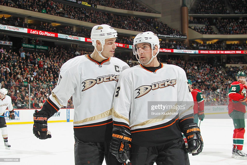 <a gi-track='captionPersonalityLinkClicked' href=/galleries/search?phrase=Ryan+Getzlaf&family=editorial&specificpeople=602655 ng-click='$event.stopPropagation()'>Ryan Getzlaf</a> #15 and <a gi-track='captionPersonalityLinkClicked' href=/galleries/search?phrase=Francois+Beauchemin&family=editorial&specificpeople=604125 ng-click='$event.stopPropagation()'>Francois Beauchemin</a> #23 of the Anaheim Ducks talk during a break in the game against the Minnesota Wild on March 12, 2013 at the Xcel Energy Center in Saint Paul, Minnesota.