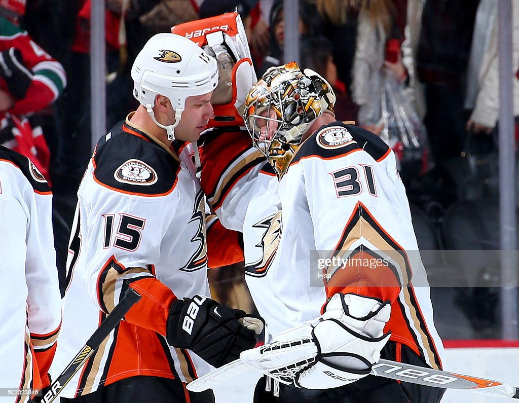 Ryan Getzlaf #15 and Frederik Andersen #31 of the Anaheim Ducks celebrate the win over t he New Jersey Devils on December 19, 2015 at Prudential Center in Newark, New Jersey.The Anaheim Ducks defeated the New Jersey Devils 2-1.