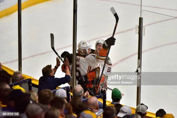 Ryan Getzlaf and Jakob Silfverberg of the Anaheim Ducks celebrate after a first period goal by Rickard Rakell against the Nashville Predators in Game...