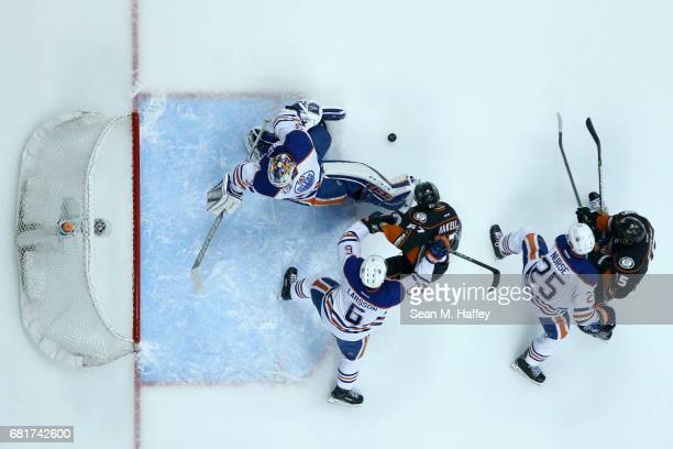 Ryan Getzlaf and Rickard Rakell of the Anaheim Ducks battle Adam Larsson Cam Talbot and Darnell Nurse of the Edmonton Oilers during the first period...