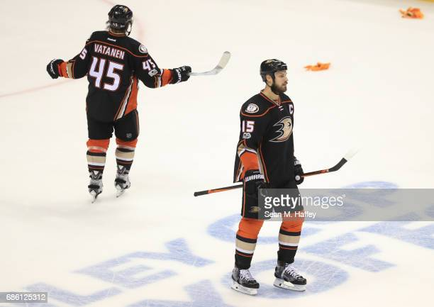 Ryan Getzlaf and Sami Vatanen of the Anaheim Ducks look on dejectedly after giving up an empty net goal in the third period of Game Five of the...
