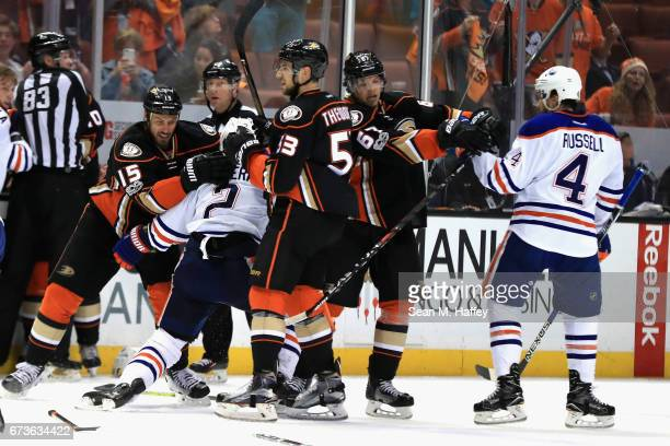 Ryan Getzlaf and Shea Theodore of the Anaheim Ducks push Kris Russell and Andrej Sekera of the Edmonton Oilers in the third period in Game One of the...