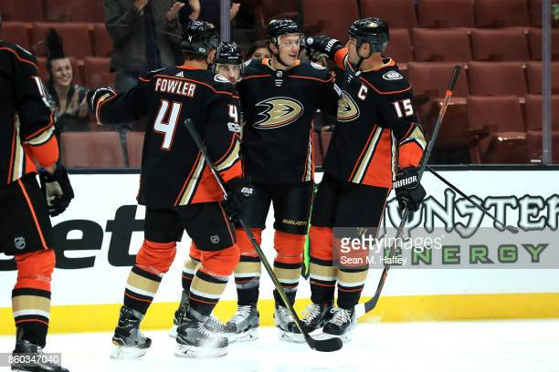 Ryan Getzlaf Cam Fowler and Josh Manson congratulate Andrew Cogliano of the Anaheim Ducks after his goal during the first period of a game at Honda...