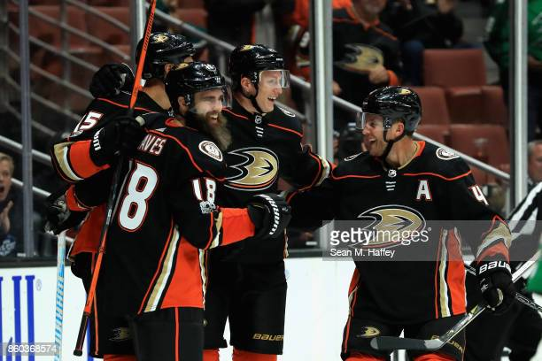 Ryan Getzlaf Cam Fowler and Josh Manson congratulate Patrick Eaves of the Anaheim Ducks after his goal during the third period of a game against the...