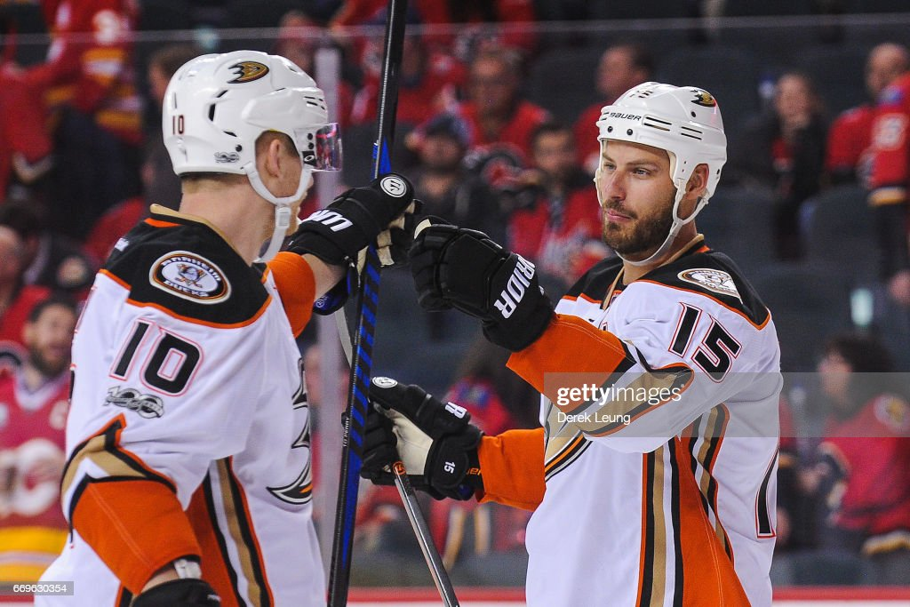 Ryan Getzlaf #15 (R) congratulates Corey Perry #10 (L) of the Anaheim Ducks after Perry scored the overtime game winner against the Calgary Flames in Game Three of the Western Conference First Round during the 2017 NHL Stanley Cup Playoffs at Scotiabank Saddledome on April 17, 2017 in Calgary, Alberta, Canada.