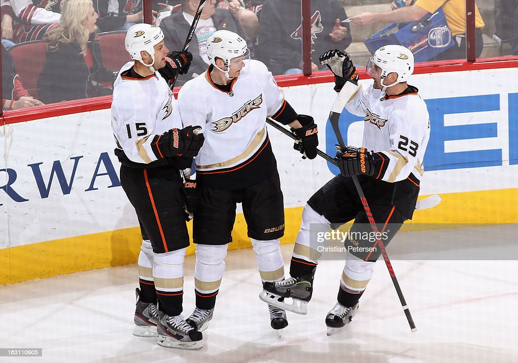 Ryan Getzlaf #15, Corey Perry #10 and Francois Beauchemin #23 of the Anaheim Ducks celebrate after Getzlaf scored a short handed goal against the Phoenix Coyotes during the second period of the NHL game at Jobing.com Arena on March 4, 2013 in Glendale, Arizona.