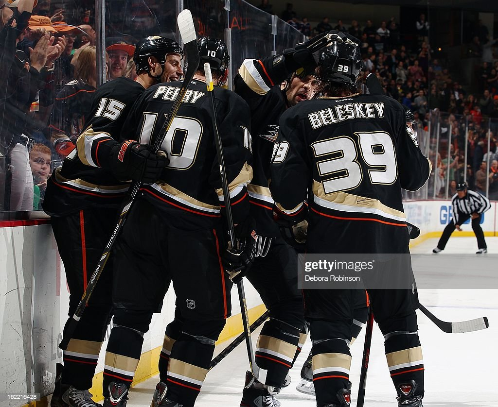 Ryan Getzlaf #15, Corey Perry #10 and Matt Beleskey #39 of the Anaheim Ducks celebrate with teammates after a Ducks goal against the Columbus Blue Jackets on February 18, 2013 at Honda Center in Anaheim, California.
