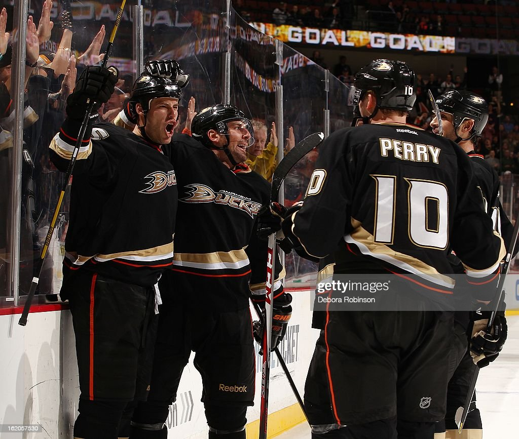 <a gi-track='captionPersonalityLinkClicked' href=/galleries/search?phrase=Ryan+Getzlaf&family=editorial&specificpeople=602655 ng-click='$event.stopPropagation()'>Ryan Getzlaf</a> #15, <a gi-track='captionPersonalityLinkClicked' href=/galleries/search?phrase=Francois+Beauchemin&family=editorial&specificpeople=604125 ng-click='$event.stopPropagation()'>Francois Beauchemin</a> #23 and <a gi-track='captionPersonalityLinkClicked' href=/galleries/search?phrase=Corey+Perry&family=editorial&specificpeople=213864 ng-click='$event.stopPropagation()'>Corey Perry</a> #10 of the Anaheim Ducks celebrate a goal against the Columbus Blue Jackets on February 18, 2013 at Honda Center in Anaheim, California.