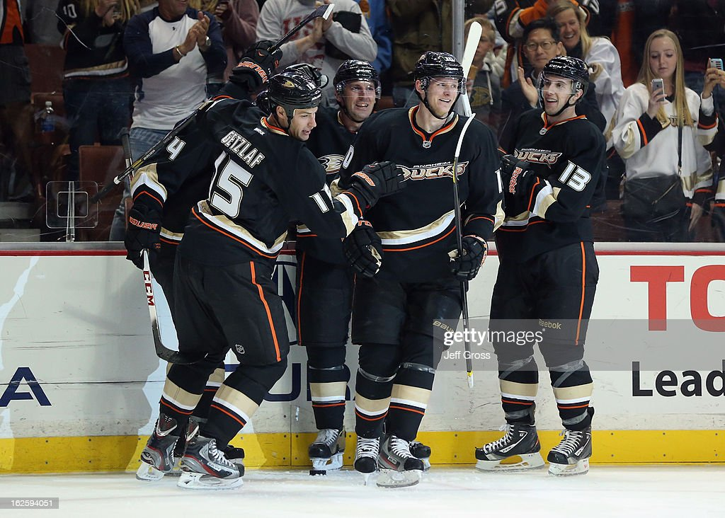 Ryan Getzlaf #15, Francois Beauchemin #23, Corey Perry #10 and Nick Bonino #13 of the Anaheim Ducks celebrate Getzlaf's goal in the third period against the Colorado Avalanche at Honda Center on February 24, 2013 in Anaheim, California. The Ducks defeated the Avalanche 4-3 in overtime.