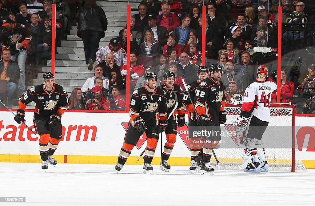 Ryan Getzlaf #15, Francois Beauchemin #23, Hampus Lindholm #47, Corey Perry #10 and Patrick Maroon #62 of the Anaheim Ducks celebrate a goal against Craig Anderson #41 of the Ottawa Senators at Canadian Tire Centre on October 25, 2013 in Ottawa, Ontario, Canada.
