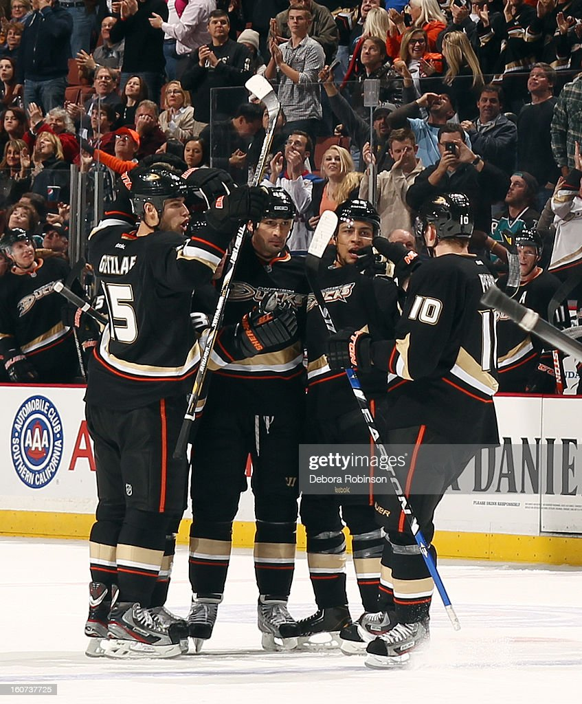 <a gi-track='captionPersonalityLinkClicked' href=/galleries/search?phrase=Ryan+Getzlaf&family=editorial&specificpeople=602655 ng-click='$event.stopPropagation()'>Ryan Getzlaf</a> #15, <a gi-track='captionPersonalityLinkClicked' href=/galleries/search?phrase=Francois+Beauchemin&family=editorial&specificpeople=604125 ng-click='$event.stopPropagation()'>Francois Beauchemin</a> #23, <a gi-track='captionPersonalityLinkClicked' href=/galleries/search?phrase=Sheldon+Souray&family=editorial&specificpeople=203131 ng-click='$event.stopPropagation()'>Sheldon Souray</a> #44, <a gi-track='captionPersonalityLinkClicked' href=/galleries/search?phrase=Emerson+Etem&family=editorial&specificpeople=6365314 ng-click='$event.stopPropagation()'>Emerson Etem</a> #65 and <a gi-track='captionPersonalityLinkClicked' href=/galleries/search?phrase=Corey+Perry&family=editorial&specificpeople=213864 ng-click='$event.stopPropagation()'>Corey Perry</a> #10 of the Anaheim Ducks, celebrate Souray's third period goal during the game against the San Jose Sharks on February 4, 2013 at Honda Center in Anaheim, California.