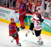 Ryan Getzlaf of Canada celebrates with Dan Boyle of Canada after scoring a goal against Evgeny Nabokov of Russia as Victor Kozlov skate by during the...