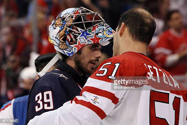 Ryan Getzlaf of Canada speaks with goalkeeper Ryan Miller of the United States following Canada's 32 overtime victory during the ice hockey men's...