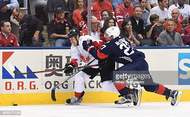 Ryan Getzlaf of Team Canada battles for the puck with Ryan McDonagh during the World Cup of Hockey 2016 at Air Canada Centre on September 20 2016 in...