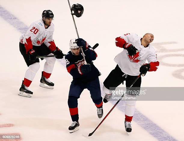 Ryan Getzlaf of Team Canada loses his helmet on a hit from Patrick Kane of Team USA in the first period during the World Cup of Hockey at the Air...