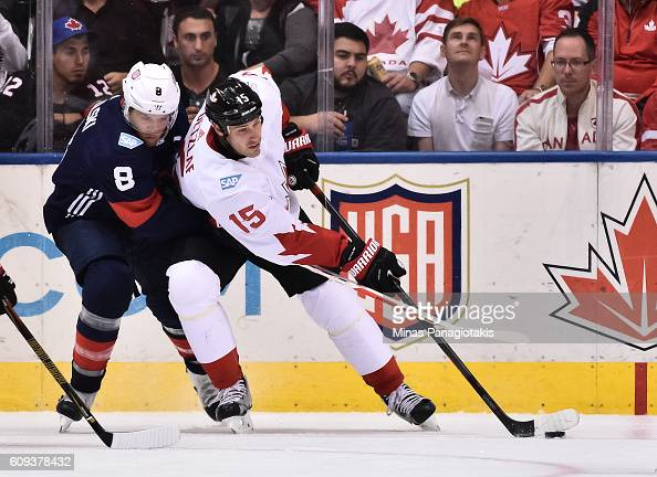 Ryan Getzlaf of Team Canada stickhandles the puck with pressure from Joe Pavelski of Team USA during the World Cup of Hockey 2016 at Air Canada...