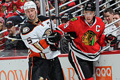 Ryan Getzlaf of the Anaheim Ducks and Jonathan Toews of the Chicago Blackhawks get physical in the second period of the NHL game at the United Center...