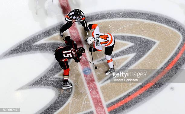 Ryan Getzlaf of the Anaheim Ducks and Sean Couturier of the Philadelphia Flyers take the opening face off on December 27 2015 at Honda Center in...