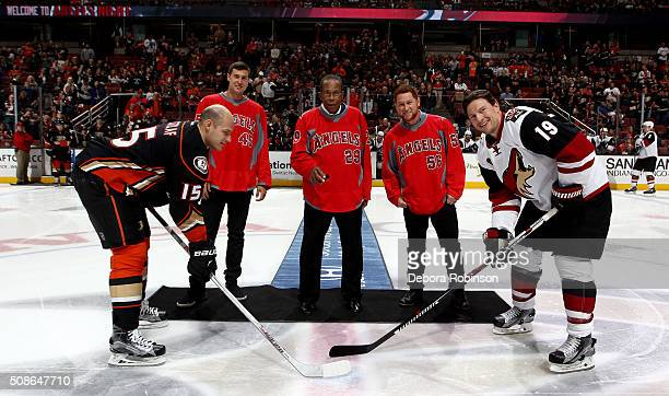 Ryan Getzlaf of the Anaheim Ducks and Shane Doan of the Arizona Coyotes take the face off from Los Angeles Angels of Anaheim players Kole Calhoun and...