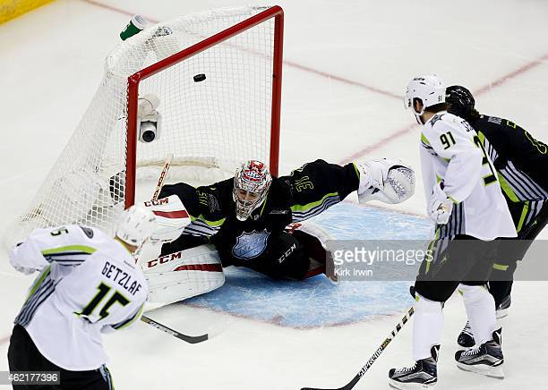 Ryan Getzlaf of the Anaheim Ducks and Team Toews scores against Carey Price of the Montreal Canadiens and Team Foligno in the first period during the...