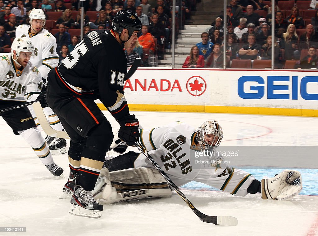 <a gi-track='captionPersonalityLinkClicked' href=/galleries/search?phrase=Ryan+Getzlaf&family=editorial&specificpeople=602655 ng-click='$event.stopPropagation()'>Ryan Getzlaf</a> #15 of the Anaheim Ducks attempts a shot on goal against <a gi-track='captionPersonalityLinkClicked' href=/galleries/search?phrase=Kari+Lehtonen&family=editorial&specificpeople=211612 ng-click='$event.stopPropagation()'>Kari Lehtonen</a> #32 of the Dallas Stars on April 3, 2013 at Honda Center in Anaheim, California.
