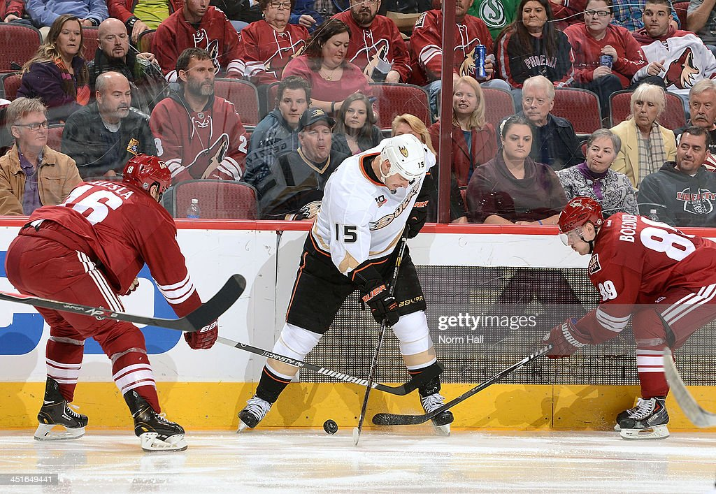 <a gi-track='captionPersonalityLinkClicked' href=/galleries/search?phrase=Ryan+Getzlaf&family=editorial&specificpeople=602655 ng-click='$event.stopPropagation()'>Ryan Getzlaf</a> #15 of the Anaheim Ducks battles for a loose puck between <a gi-track='captionPersonalityLinkClicked' href=/galleries/search?phrase=Rostislav+Klesla&family=editorial&specificpeople=207079 ng-click='$event.stopPropagation()'>Rostislav Klesla</a> #16 and <a gi-track='captionPersonalityLinkClicked' href=/galleries/search?phrase=Mikkel+Boedker&family=editorial&specificpeople=4697252 ng-click='$event.stopPropagation()'>Mikkel Boedker</a> #89 of the Phoenix Coyotes during the third period at Jobing.com Arena on November 23, 2013 in Glendale, Arizona.