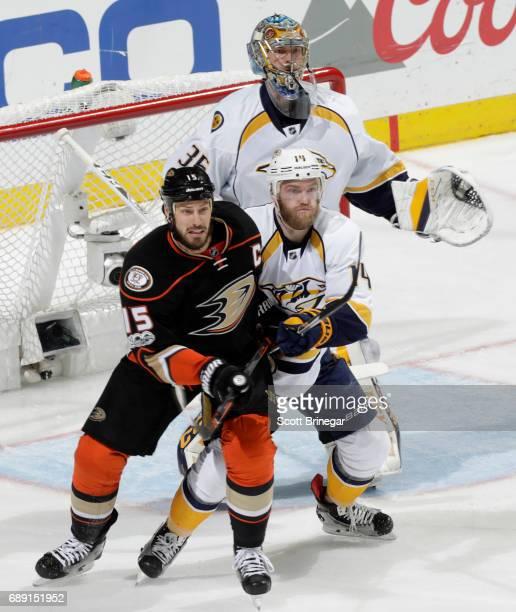 Ryan Getzlaf of the Anaheim Ducks battles for position against Mattias Ekholm and Pekka Rinne of the Nashville Predators in Game Five of the Western...