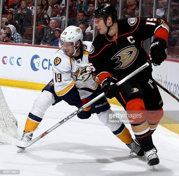 Ryan Getzlaf of the Anaheim Ducks battles for position against Calle Jarnkrok of the Nashville Predators on March 15 2015 at Honda Center in Anaheim...