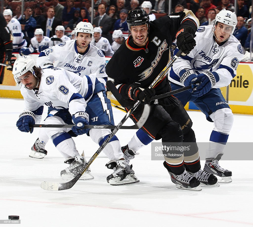 <a gi-track='captionPersonalityLinkClicked' href=/galleries/search?phrase=Ryan+Getzlaf&family=editorial&specificpeople=602655 ng-click='$event.stopPropagation()'>Ryan Getzlaf</a> #15 of the Anaheim Ducks battles for the puck against <a gi-track='captionPersonalityLinkClicked' href=/galleries/search?phrase=Valtteri+Filppula&family=editorial&specificpeople=2234404 ng-click='$event.stopPropagation()'>Valtteri Filppula</a> #51 and <a gi-track='captionPersonalityLinkClicked' href=/galleries/search?phrase=Mark+Barberio&family=editorial&specificpeople=4819242 ng-click='$event.stopPropagation()'>Mark Barberio</a> #8 of the Tampa Bay Lightning on November 22, 2013 at Honda Center in Anaheim, California.