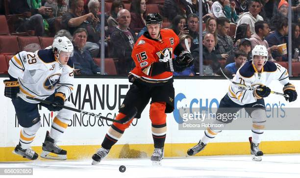 Ryan Getzlaf of the Anaheim Ducks battles for the puck against Jake McCabe and Evan Rodrigues of the Buffalo Sabres during the game on March 17 2017...