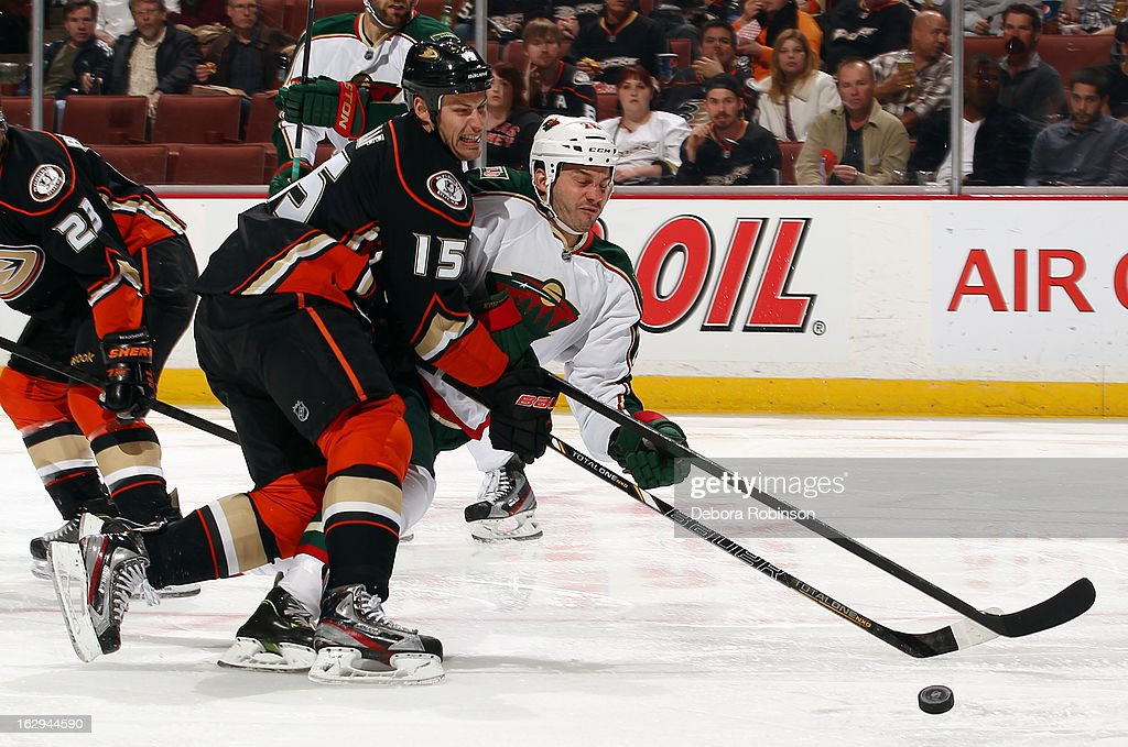 <a gi-track='captionPersonalityLinkClicked' href=/galleries/search?phrase=Ryan+Getzlaf&family=editorial&specificpeople=602655 ng-click='$event.stopPropagation()'>Ryan Getzlaf</a> #15 of the Anaheim Ducks battles for the puck against <a gi-track='captionPersonalityLinkClicked' href=/galleries/search?phrase=Zenon+Konopka&family=editorial&specificpeople=2105876 ng-click='$event.stopPropagation()'>Zenon Konopka</a> #28 of the Minnesota Wild on March 1, 2013 at Honda Center in Anaheim, California.