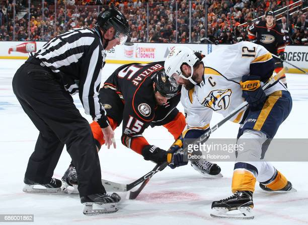 Ryan Getzlaf of the Anaheim Ducks battles in a faceoff against Mike Fisher of the Nashville Predators in Game Two of the Western Conference Final...