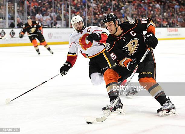 Ryan Getzlaf of the Anaheim Ducks breaks in past Mark Giordano of the Calgary Flames for a backhand during the third period of an 83 Ducks win at...