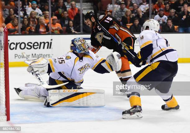 Ryan Getzlaf of the Anaheim Ducks can't put the puck around the leg pad of goaltender Pekka Rinne of the Nashville Predators as Ryan Ellis of the...