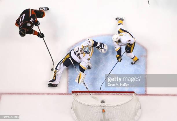 Ryan Getzlaf of the Anaheim Ducks can't put the puck past the leg pad of goaltender Pekka Rinne of the Nashville Predators as Ryan Ellis of the...